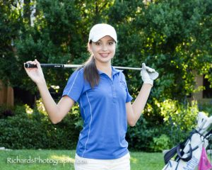 senior pictures girl in golf outfit