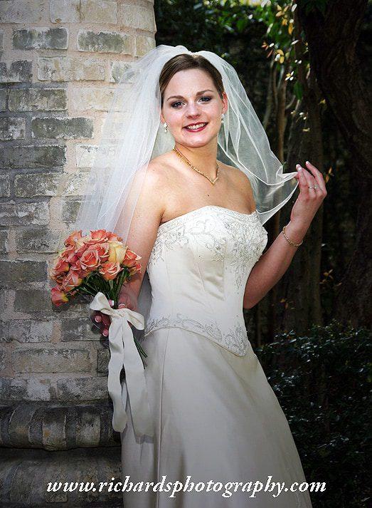 Bride photograph holding her wedding veil