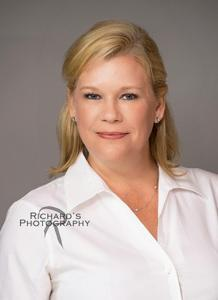 Woman Headshot For Company Website dressed in white blouse