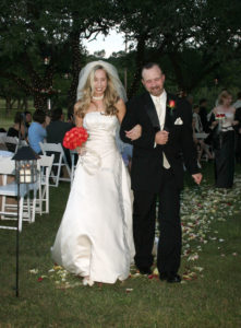 Portrait Bride and Groom Walking Down Aisle at Wedding in San Antonio