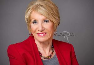 Woman headshot in red jacket