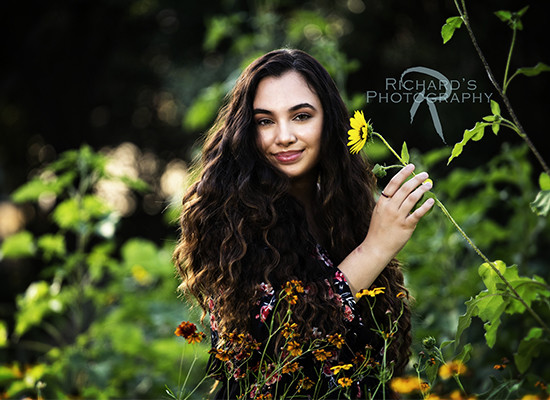 senior pictures san antonio girl long hair taken at Richard's Photography outdoors in sunflowers