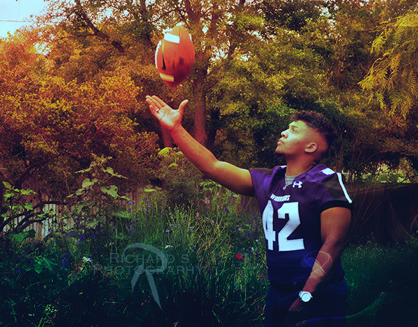 christmas senior portraits of boy in purple football jersey from san antonio