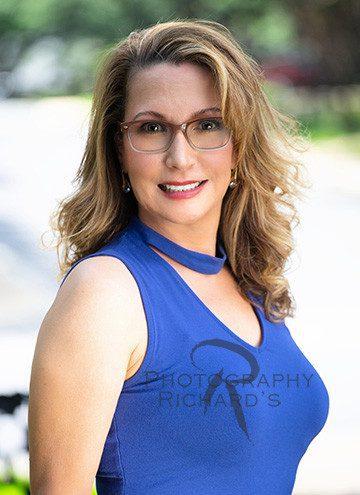 outdoor woman headshot wearing blue shirt