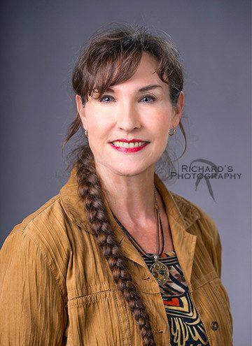 indoor studio professional headshot woman in brown