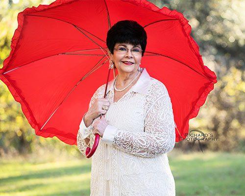 woman-holding-umbrella-outdoor-portrait
