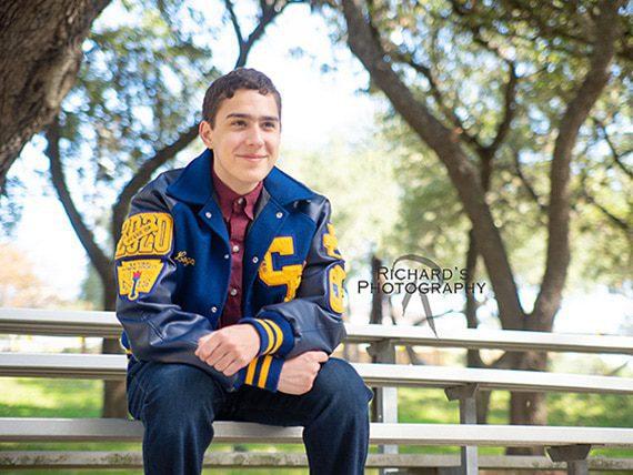 outdoor graduation portrait boy letter jacket san antonio