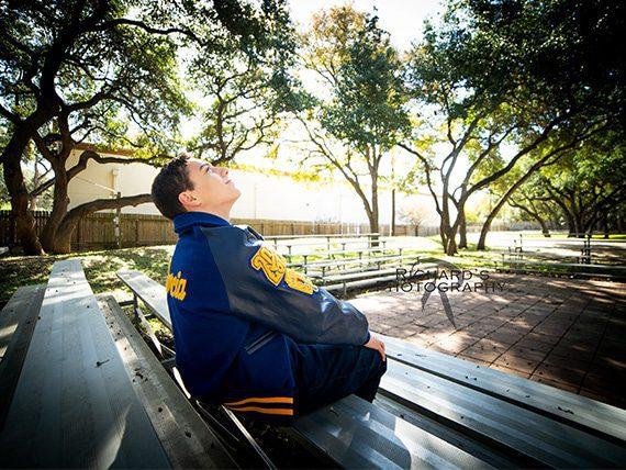 senior pictures outdoor letter jacket san antonio boy