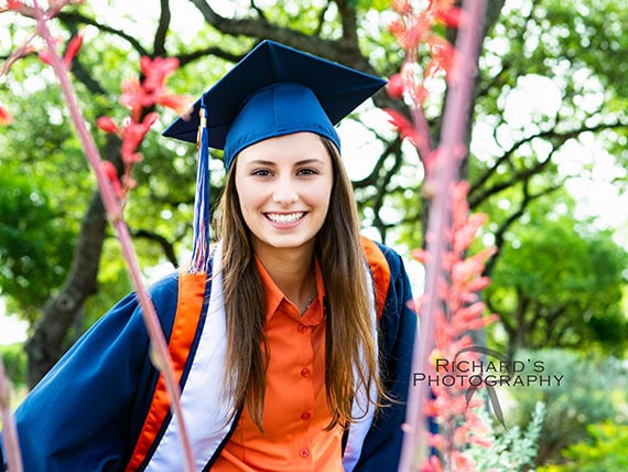 UTSA graduation portraits in cap and gown on campus