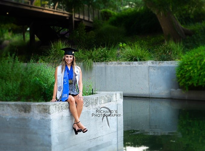 senior pictures girl sitting san antonio river walk at pearl brewery