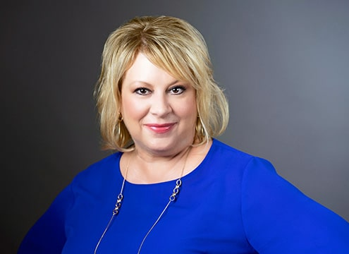 woman professional headshot in blue san antonio