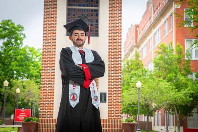 UIW graduation portrait cap and gown