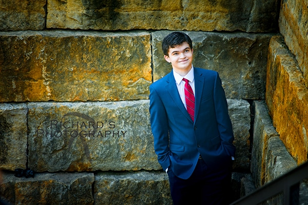 senior portraits pearl brewery boy suit and tie