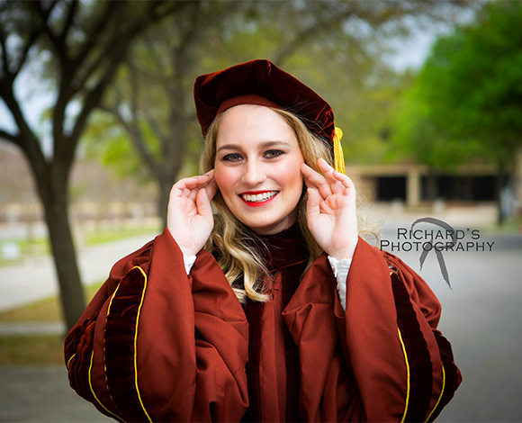 graduation portraits cap and gown medical student on campus in san antonio
