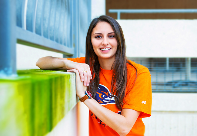 UTSA girl graduation pictures orange shirt