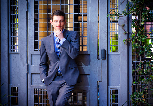 graduation portraits in suit and tie GQ stylish