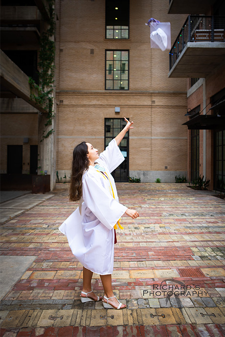 cap anp gown toss senior portraits the pearl brewery