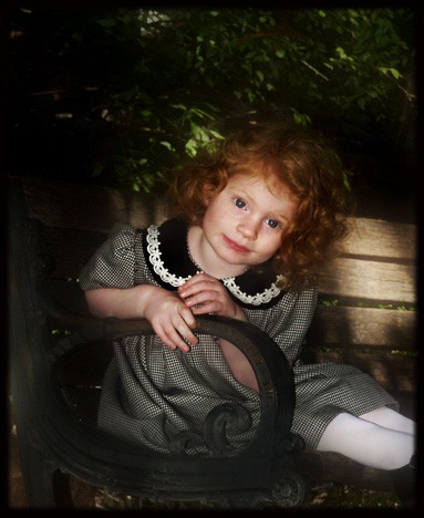 Young girl with curly red hair