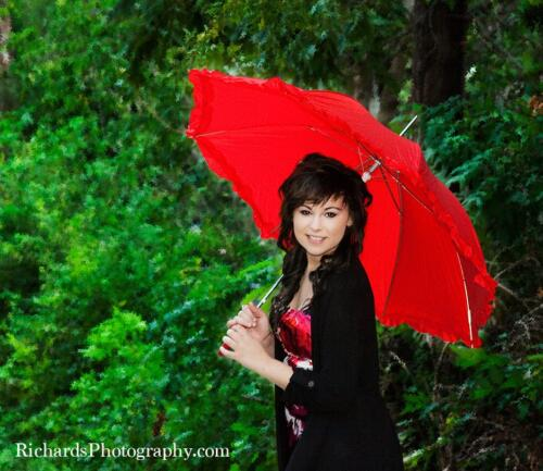 portrait girl standing with red umbrella