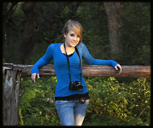 high school senior outdoors with camera