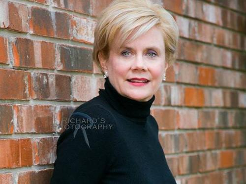 outdoor business woman headshot san antonio texas wearing black sweater