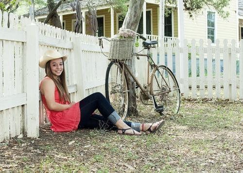 girl with hat and bicycle graduation portrait san antonio