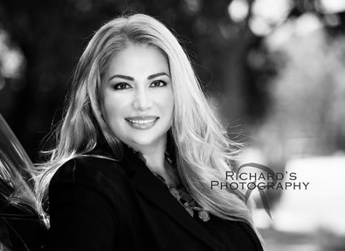 black and white headshot woman blonde hair