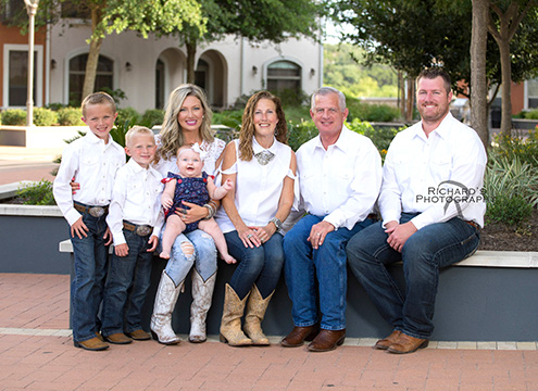 family group portraits in white outfits