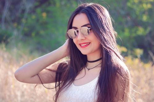 graduation portrait girl wearing sun glasses