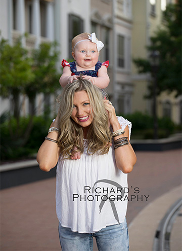 mother with baby daughter at portrait session san antonio landmark