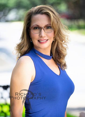 outdoor professional headshot of woman blue top glasses san antonio