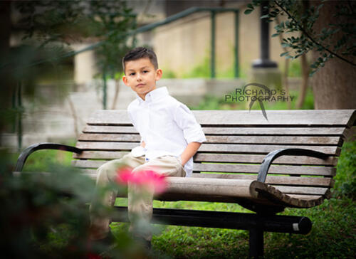 portrait of boy at family photo session pearl brewery river walk area