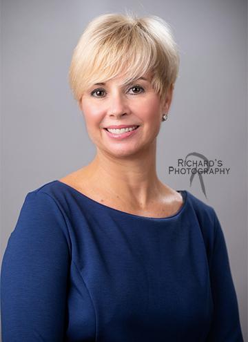 portrait of woman in blue shirt blonde hair corporate san antonio