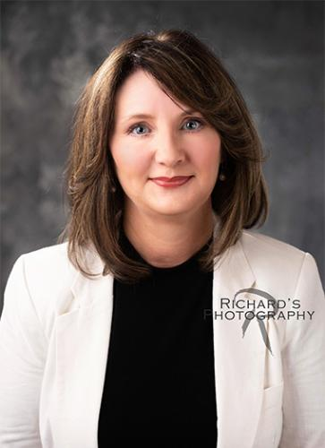 real estate photography san antonio agent headshot white coat woman