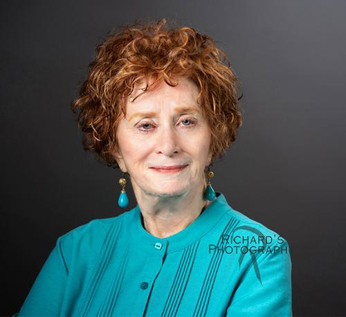 older woman with red hair photo