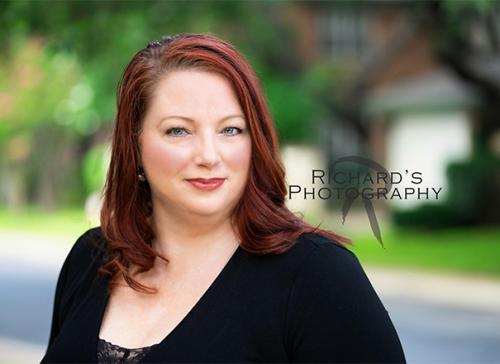woman with red hair outdoor business photo